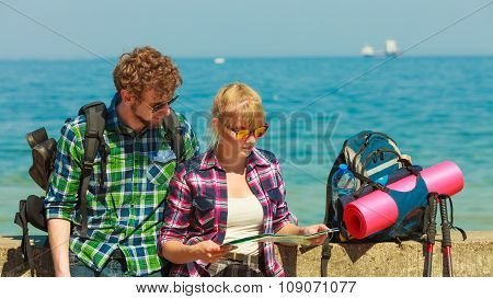 Couple Backpacker With Map By Seaside
