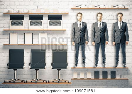 Office Kit Tools Concept With Workers And Office Accessories At White Brick Background
