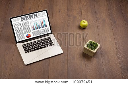 Computer laptop on wooden desk with office accessories
