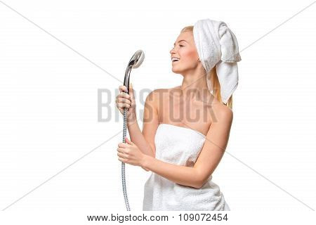 Happy pretty woman in towel singing using shower having fun