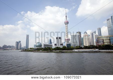 SHANGHAI, CHINA, JULY 25, 2015: The Pearl Tower and Pudong skyline with the river. China 2015