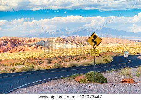 Winding Road With Signs In Valley Of Fire State Park, Nevada