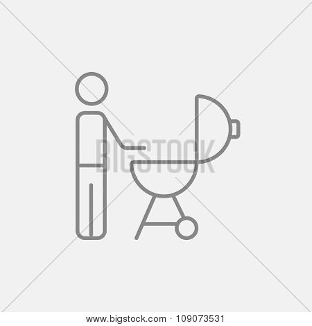 Man at kettle barbecue grill line icon for web, mobile and infographics. Vector dark grey icon isolated on light grey background.