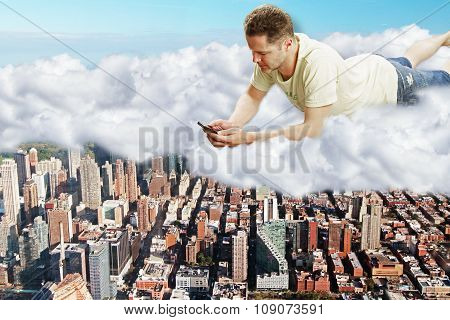 Man Lies On Clouds With Smartphone Above Megapolis City Concept