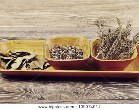 Dried Herbs and Spices in Wooden Dish