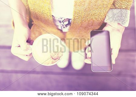 Hipster Girl With Cup Of Coffee And Blank Smartphone In Hands