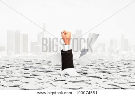 Solution Is Found Concept With Man Hand And Pile Of Paper At City Background