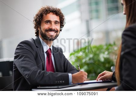 Business people working on a document while sitting in a coffee shop