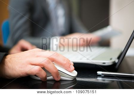 Businessman using his laptop in the office