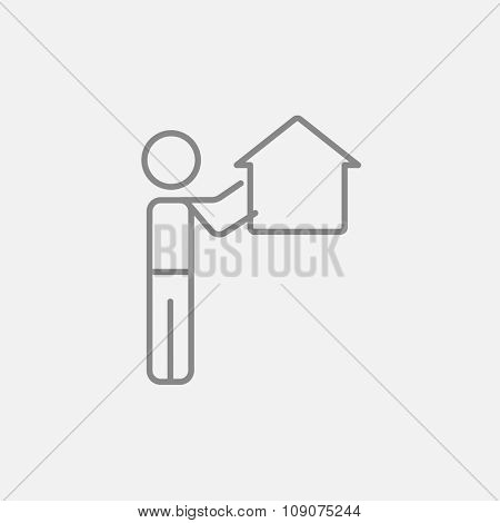 Man pointing at a house line icon for web, mobile and infographics. Vector dark grey icon isolated on light grey background.