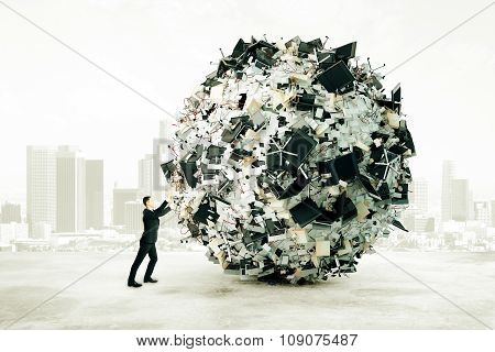 Office Dump Concept With Businessman Pushing A Big Ball Of Office Stuff