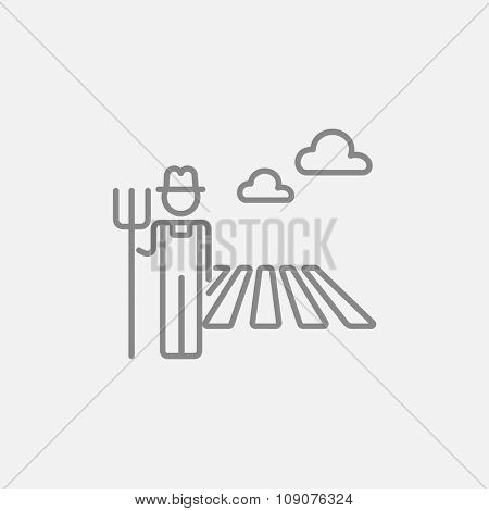 Farmer with pitchfork standing on a field line icon for web, mobile and infographics. Vector dark grey icon isolated on light grey background.