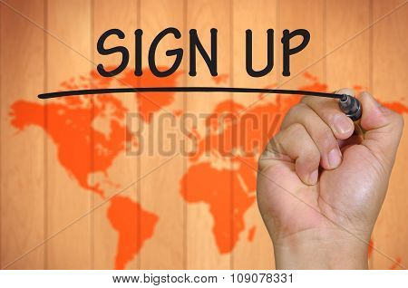 Hand Writing Sign Up Over Blur World Background