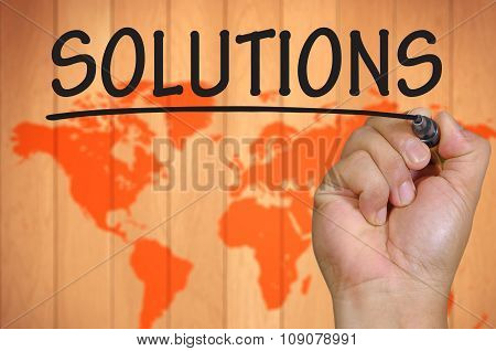 Hand Writing Solutions Over Blur World Background