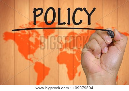 Hand Writing Policy Over Blur World Background