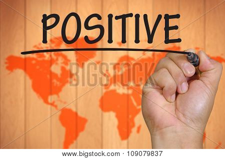 Hand Writing Positive Over Blur World Background