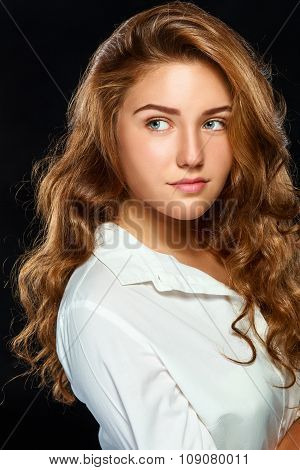 Portrait beautiful young brunette woman with wavy hair in white