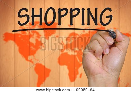 Hand Writing Shopping Over Blur World Background