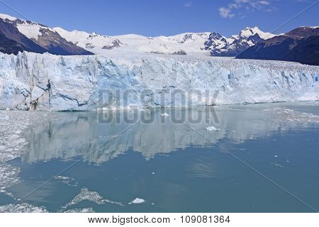 Calm Waters Below A Glacial Face