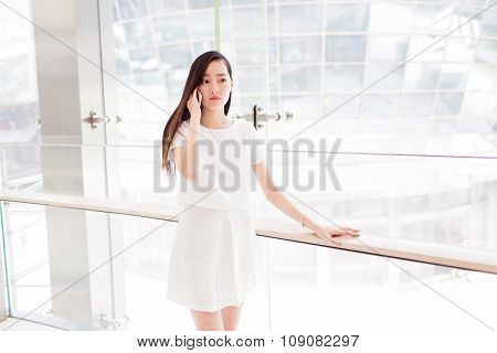 Beautiful Girl Leaning Against The Glass Window