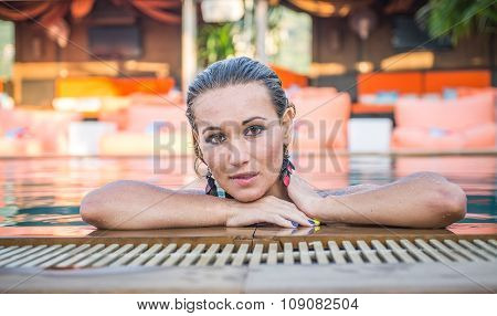Beautiful Woman Getting Out The Swimming Pool