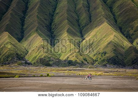 Aerial view of sea of sand inside Bromo Tengger Caldera. Mount Bromo sits in the middle of a vast plain called the