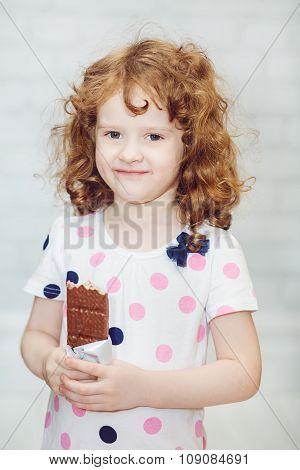 Beautiful Curly Girl Eating Chocolate