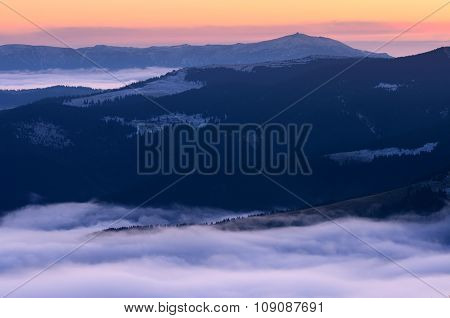 Mountain sunrise. Autumn landscape with fog on the hills. Carpathians, Ukraine, Europe