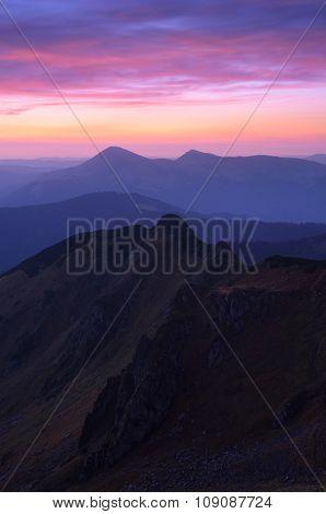Mountain landscape. Beautiful cloudy sky at sunrise. Carpathians, Ukraine, Europe