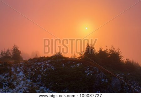 Sunlight. Sunset with fog in mountains. Beauty in nature. Autumn landscape with first snow