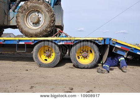 Trucker Fixing Hydraulics on his Vehicle
