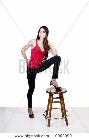 Skinny Hispanic Woman Smiling Foot On Stool
