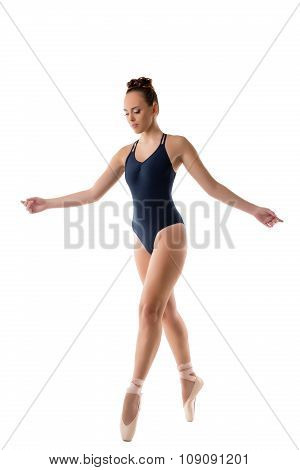Charming woman dancing in ballet pointe shoes