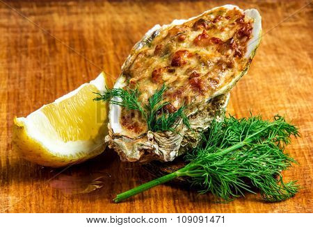 Baked oyster shell with cheese, served parsley and lemon