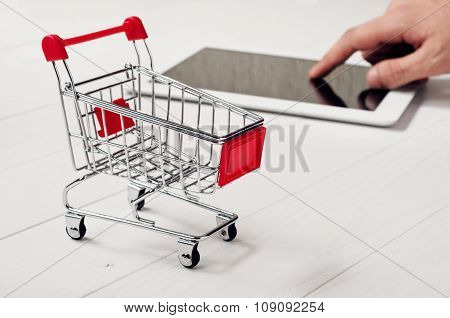 Small Trolley On The Wooden Table