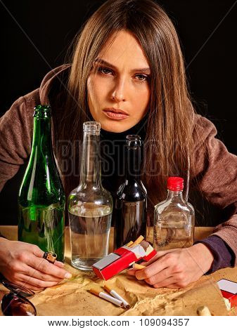 Drunk girl covers group bottles of alcohol. Soccial issue alcoholism.