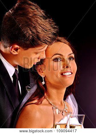 Groom kissing bride . Wedding on black portrait.