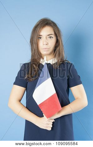 Girl Holding The French Flag Triumphantly..