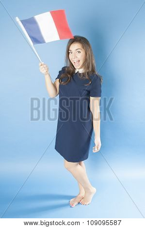 Young Girl Waves The French Flag..