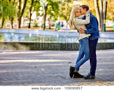 Young couple hugging and flirting in  park  meeting after a separation.