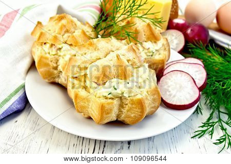 Appetizer Of Radish And Cheese In Profiteroles On White Plate