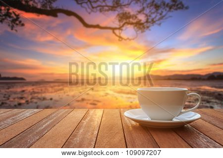 White Coffee Cup On Wood Table And View Of Sunset Or Sunrise Background