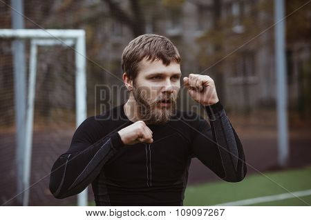 Mature Male Athlete Stretching outdoor