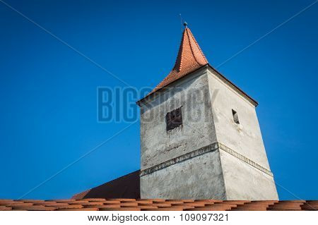 Old church tower and blue sky
