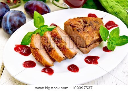 Duck Breast With Plum Sauce And Basil On Plate