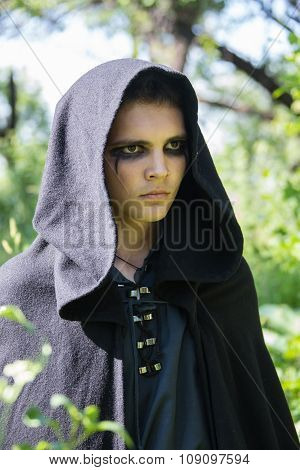 serious guy in a black robe
