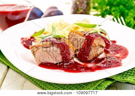 Duck Breast With Plum Sauce And Cabbage In Plate