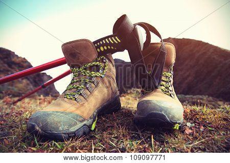hiking boots on mountain peak
