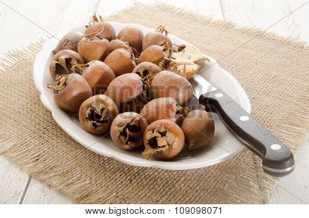 Dried Rosehip On A Plate With Knife