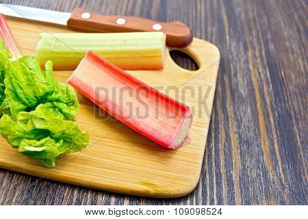 Rhubarb With Knife On Board